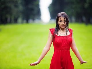 girl in red dress bathing in rain