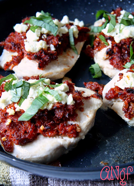 Sun-dried tomatoes mixed with bacon served over chicken breast from Anyonita-nibbles.co.uk