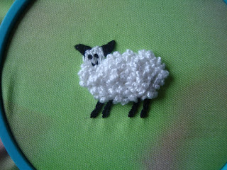 sheep worked in drizzle stitch