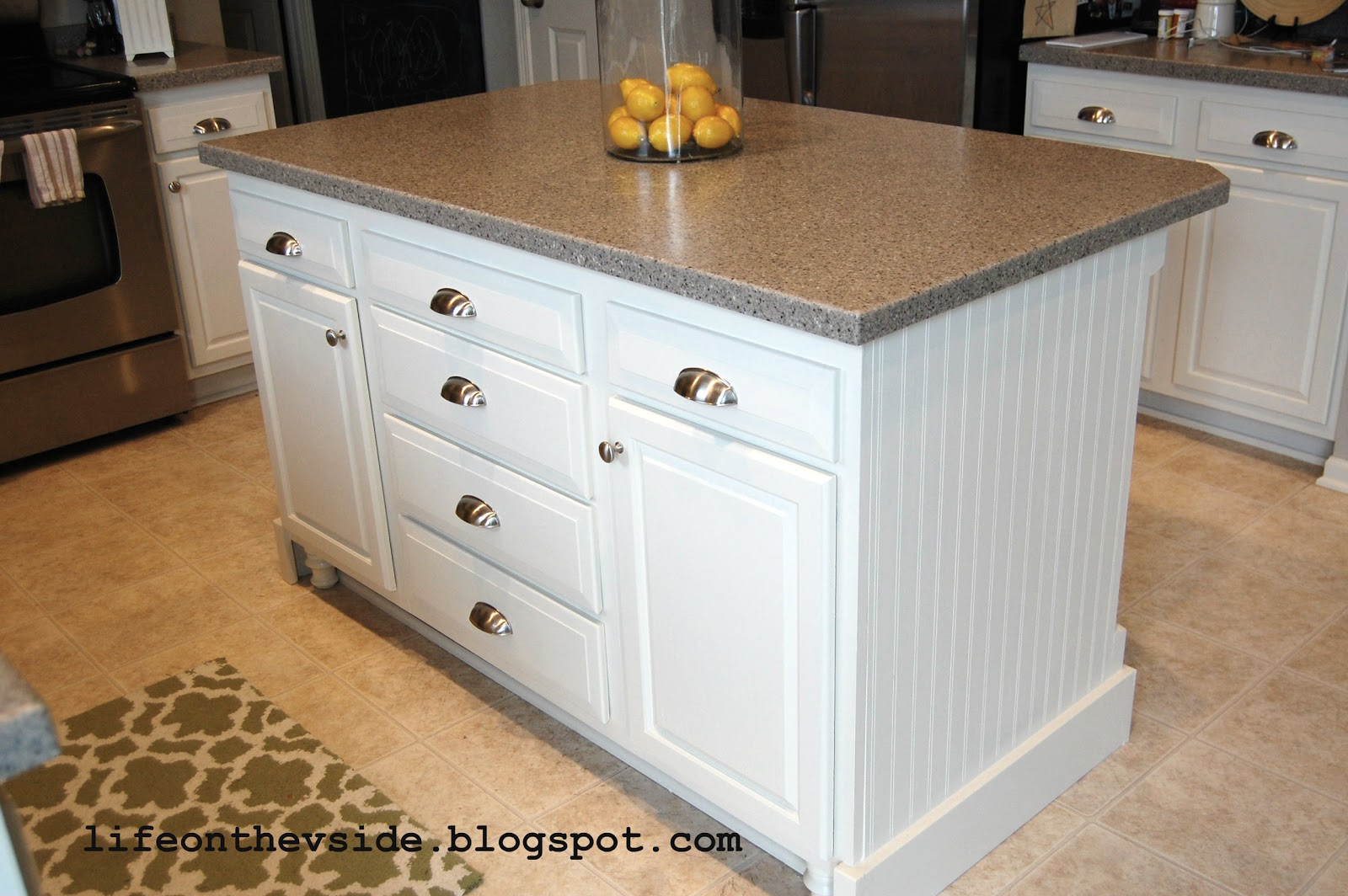 Diy by design kitchen makeover guest post on the v side for Build kitchen island with cabinets