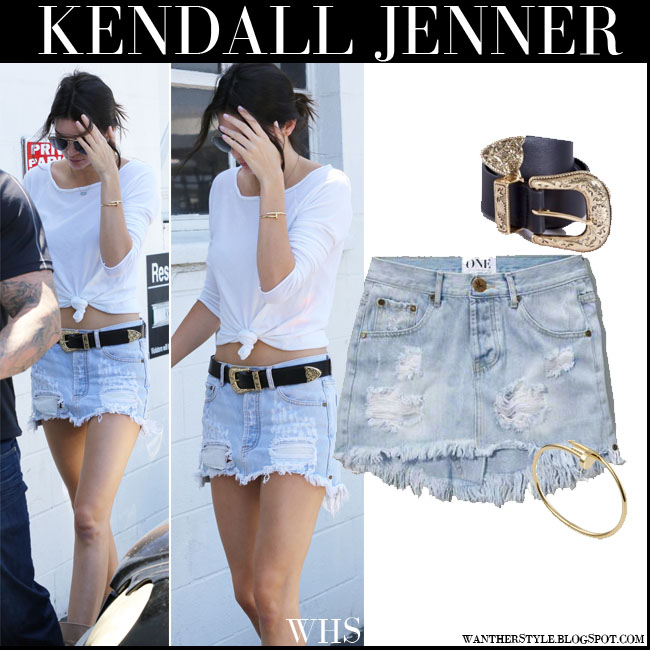 Kendall Jenner in light blue distressed denim One Teaspoon Junkyard mini skirt with white top what she wore july 27