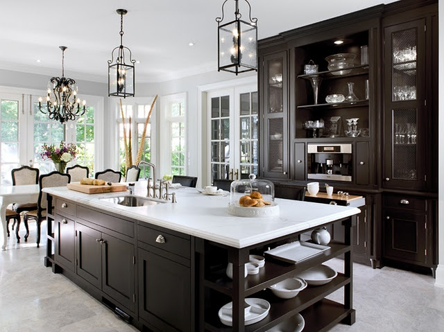Over at decorpad there are many beautiful kitchens and here is just an example how elegant a black and white kitchen can be the island is the focal point