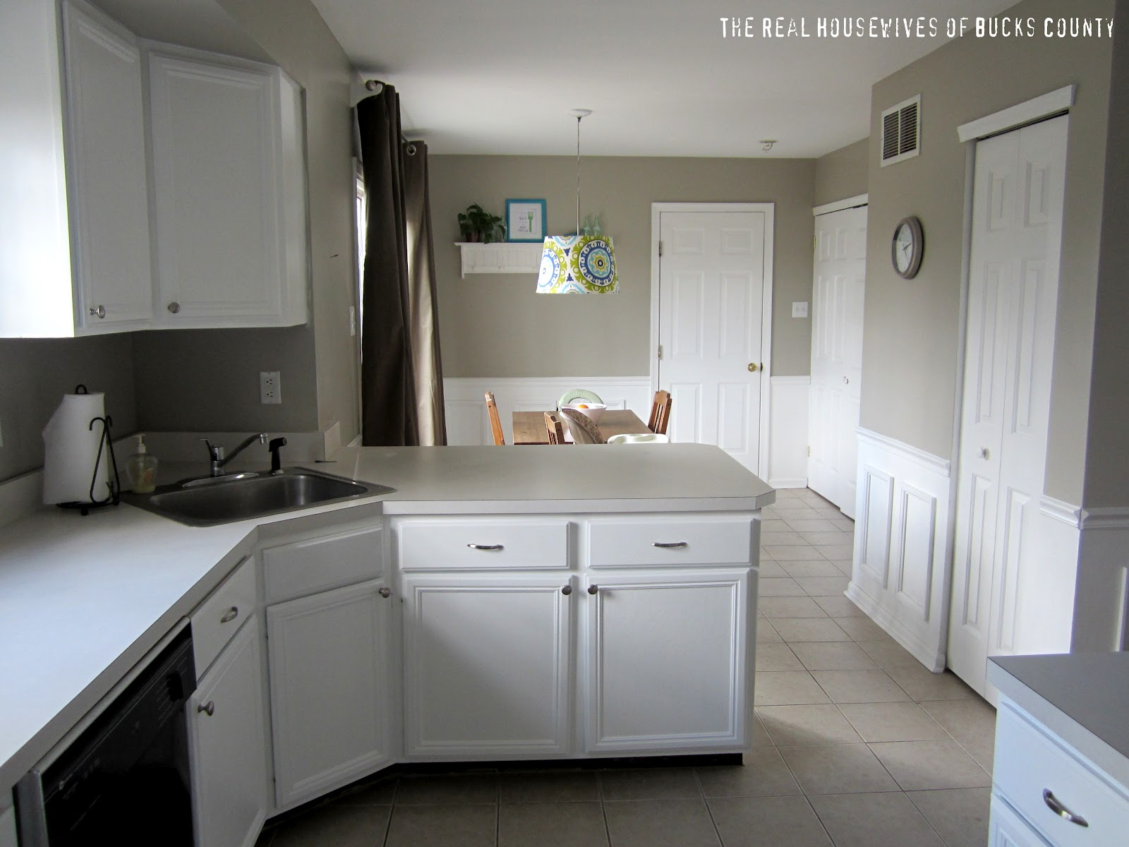 White cabinet reveal kitchen update east coast for How to paint your cabinets white