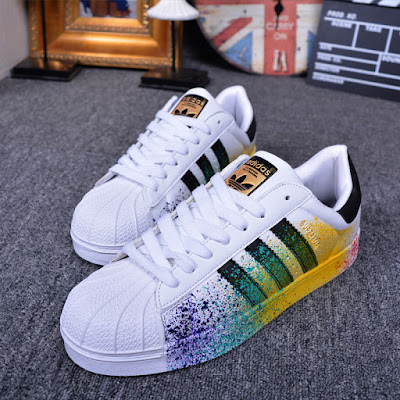 You-can-never-go-wrong-with-a-pair-of-Adidas-that-can-be-worn-by-a-male-or-female-like-these-paint-splattered-pair