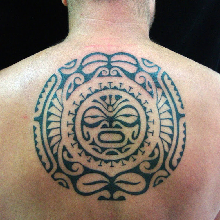 back polynesian style inspired tattoo