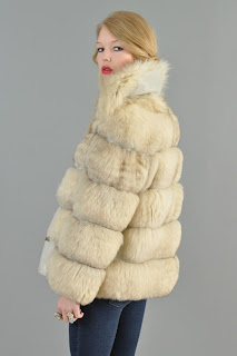 Vintage 1970's cream colored arctic fox fur coat with silver metal front turnlock closure.