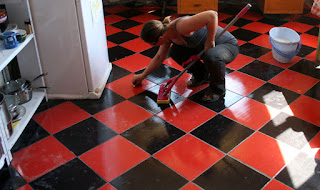 Cleaning the lovely black and red tiles of Room 13