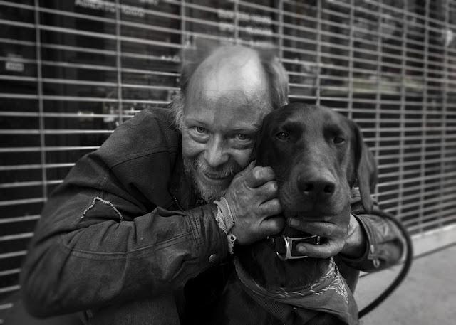 Man, dog, street (C)Glenn Primm