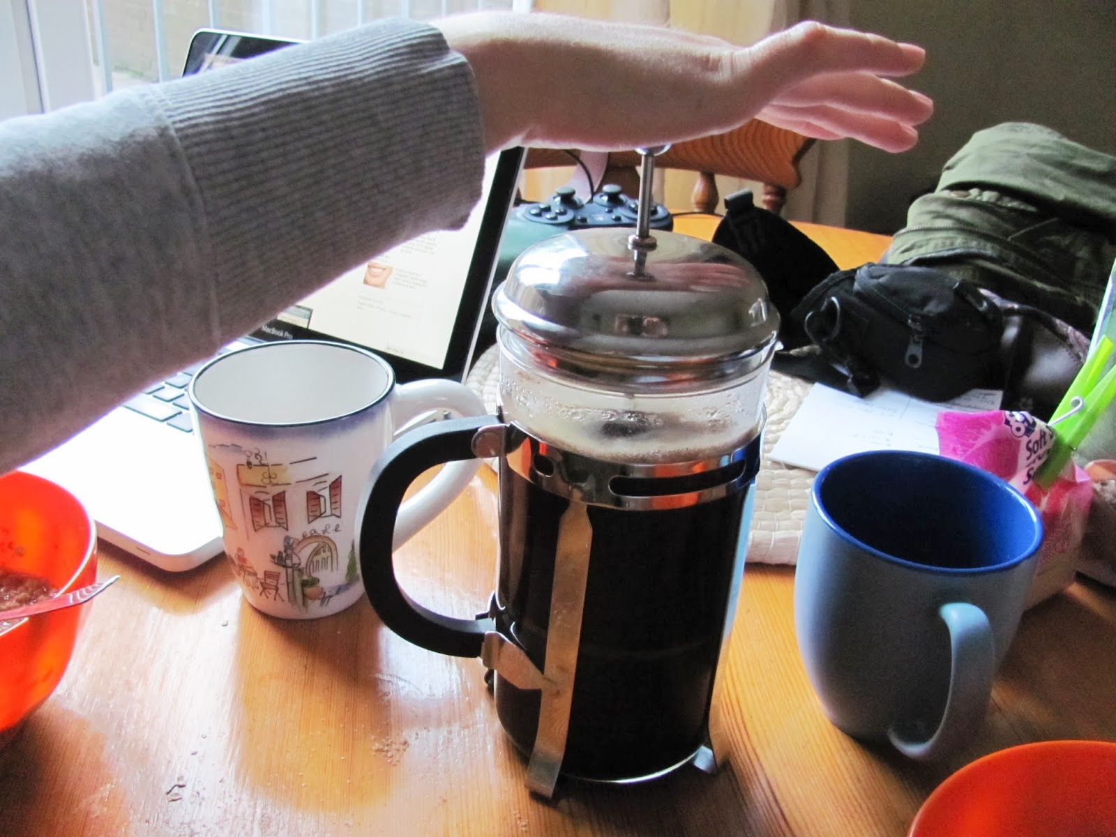 Pushing down the plunger on the cafetiere French press in Dublin, Ireland