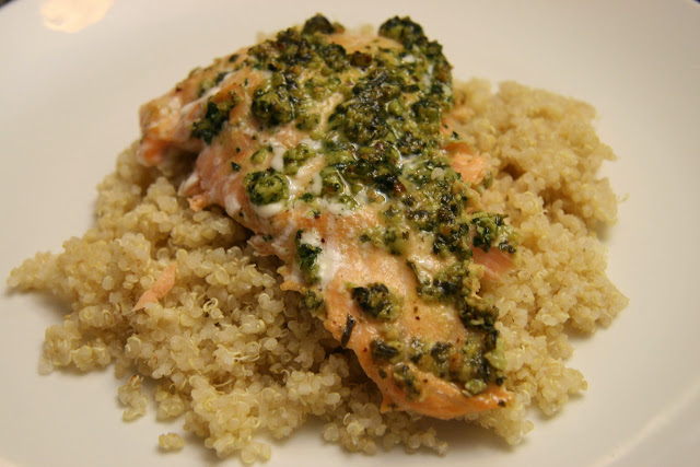 salmon topped with pesto on a bed of quinoa.