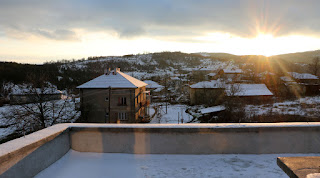 Sun glinting above our village as it sinks