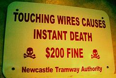 funny sign touching wires causes instant death