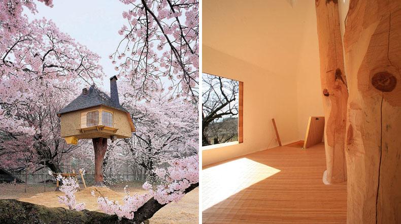 Casa del árbol de cuento de hadas flota en medio de árboles de flor de cerezo