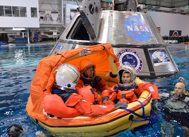 Engineers participate in testing to evaluate procedures to recover crews from Orion after splashdown in the Pacific Ocean on future missions. The training took place at the Neutral Buoyancy Laboratory at NASA's Johnson Space Center in Houston. Credits: NASA
