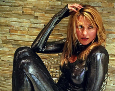 Lucy Lawless in Black Catsuit