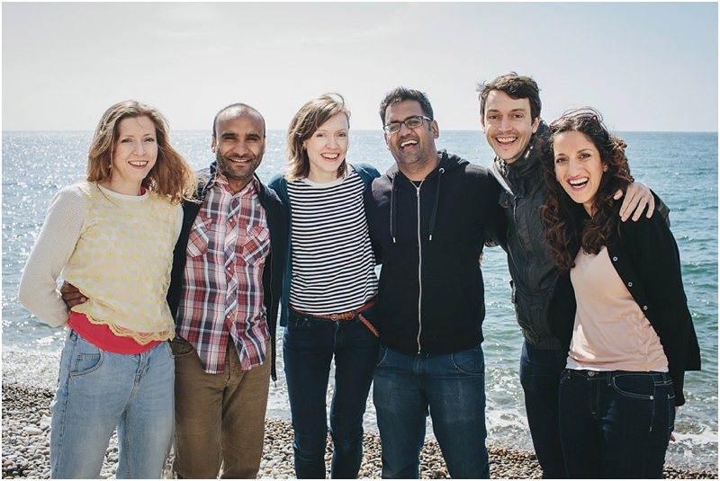 A group of people laughing at the camera