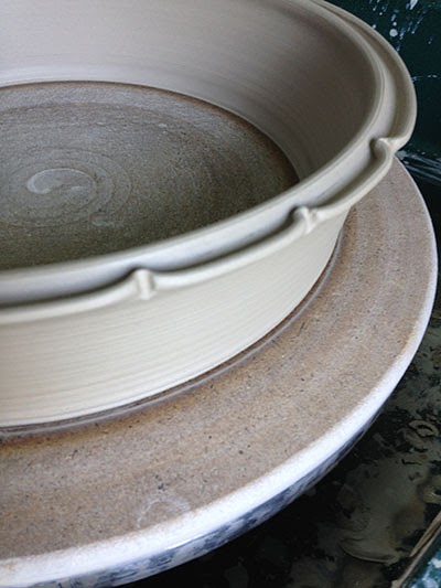 A decorative rim on a casserole by Lori Buff