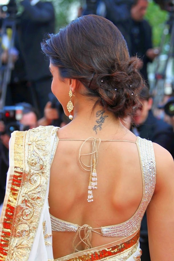 Deepika Padukone Hot deep Cleavage and Navel Photos in Saree