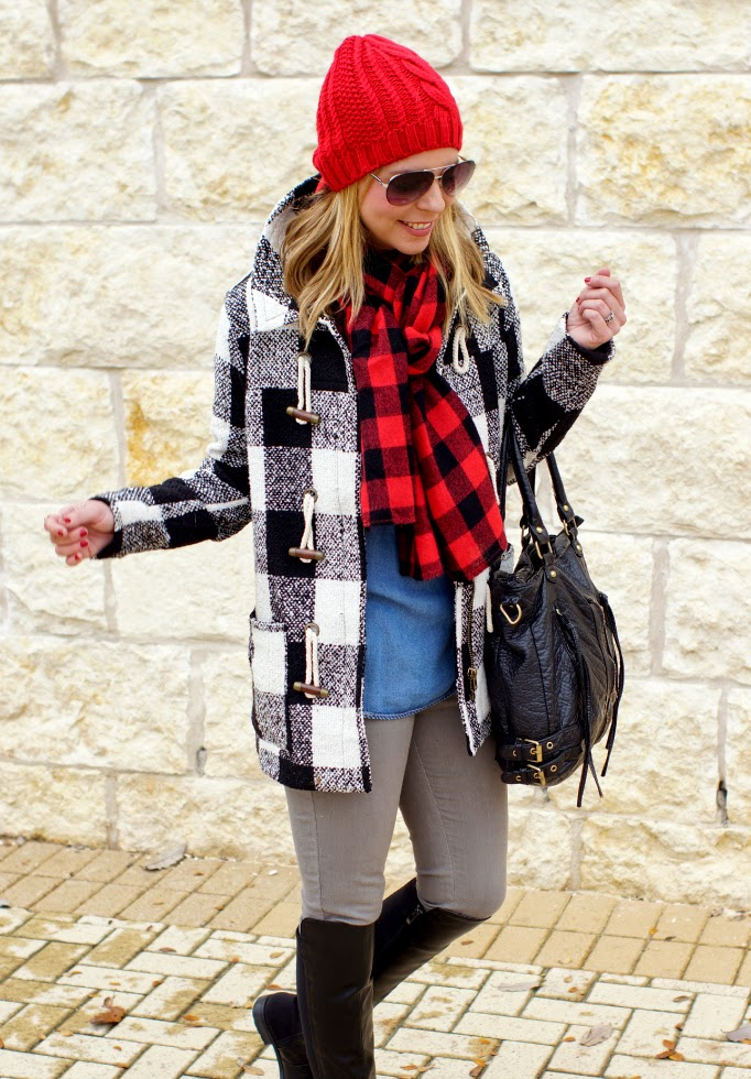 red cable knit beanie, buffalo check scarf, black and white plaid coat