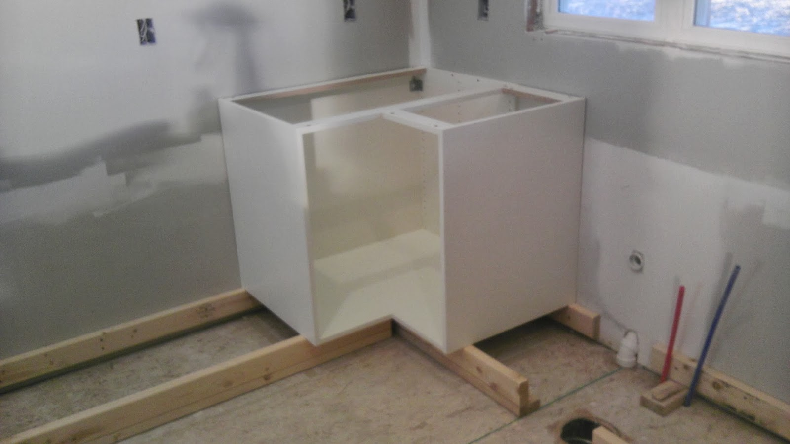 Once Upon an Acre: Installing the kitchen base cabinets