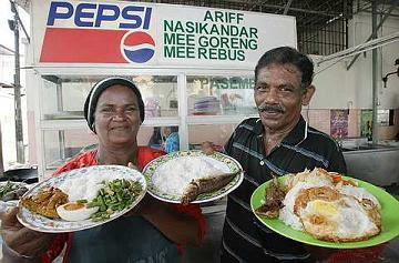 Cheap options: Ariff Abdul Rahman and his wife Baheerah Mydin showing their 1Malaysia People's Menu dishes. The prices for the respective dishes are (from left) RM3, RM2 and RM4.
