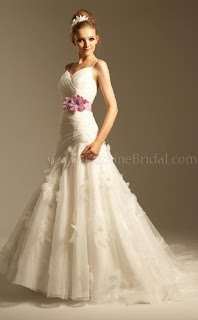 A stunning spring or summer wedding dress with flower appliques.