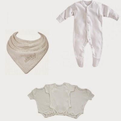 White baby vests, white newborn sleepsuits and organic Skibz bibs