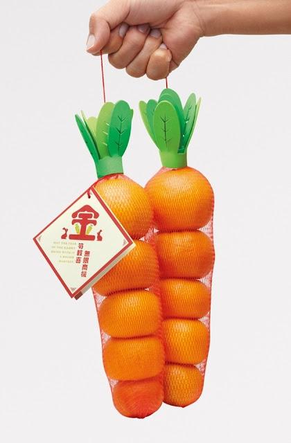 packagind de naranjas en forma de zanahoria