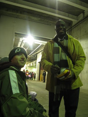 Washington Redskins' London Fletcher signing autographs at FedEx Field