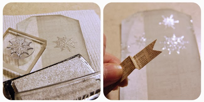 Stamp snowflakes on to the tag using silver ink; emboss with Transparent Silver embossing powder Cut a strip of dictionary paper approximately 1/2 inch wide and then notch the ends of the paper. Fold the ends to create a banner that will lay across the tag horizontally