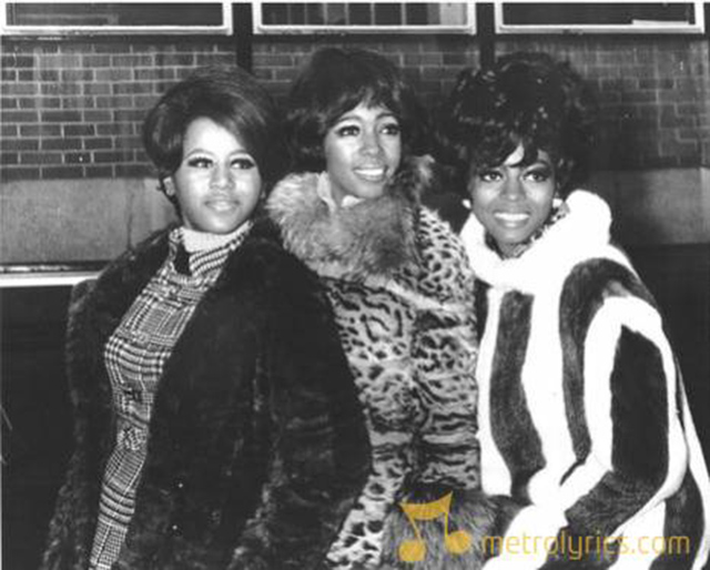 The Supremes wearing faux fur coats in the 1960s