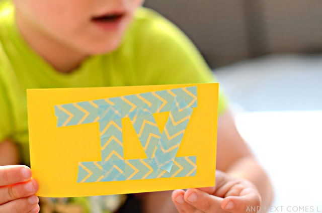 Homemade Roman Numerals flashcards with washi tape - a fine motor math craft for kids from And Next Comes L