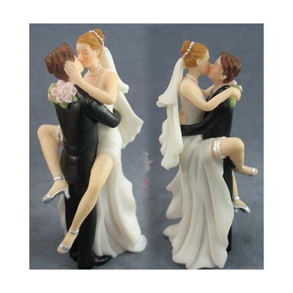 A sexy cake topper. The bride and groom can have personalised hair colours.
