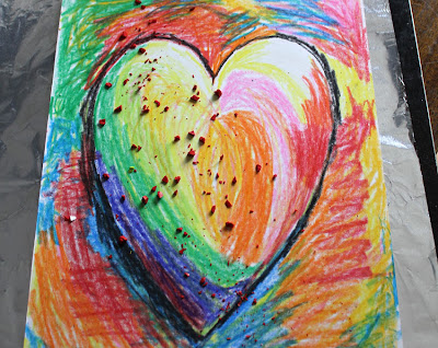 paper batik instruction drawing of a multi colored heart
