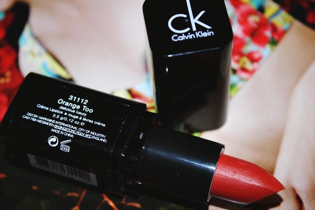 Calvin Klein: Delicious Luxury Creme Lipstick (Orange Too 112). Calvin Klein Lipstick. Calvin Klein makeup. Best orange lipsticks. Luxury makeup.