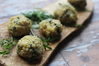 baked spinach arancini stuffed with mozzarella cheese.