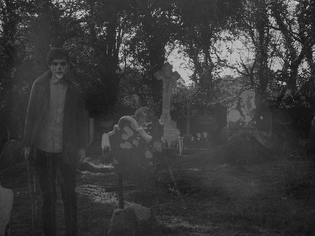 Creepy guy in cemetery