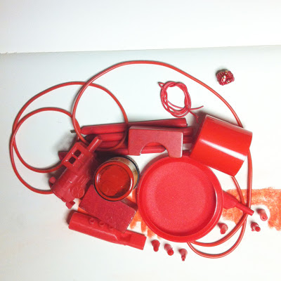 Red objects assembled together to create a picture of sorts