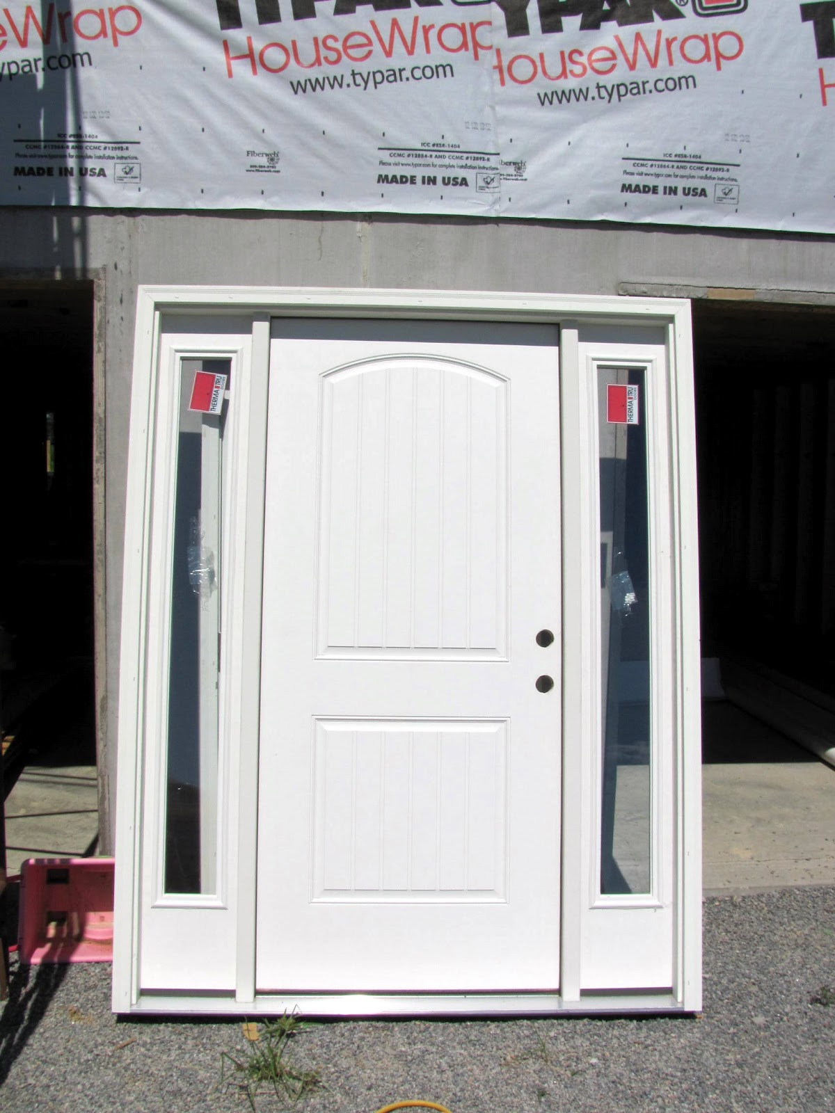 This one below is the front door and the garage door and kitchen back door are stacked behind it. & Building The Turner House: Front Door Installation
