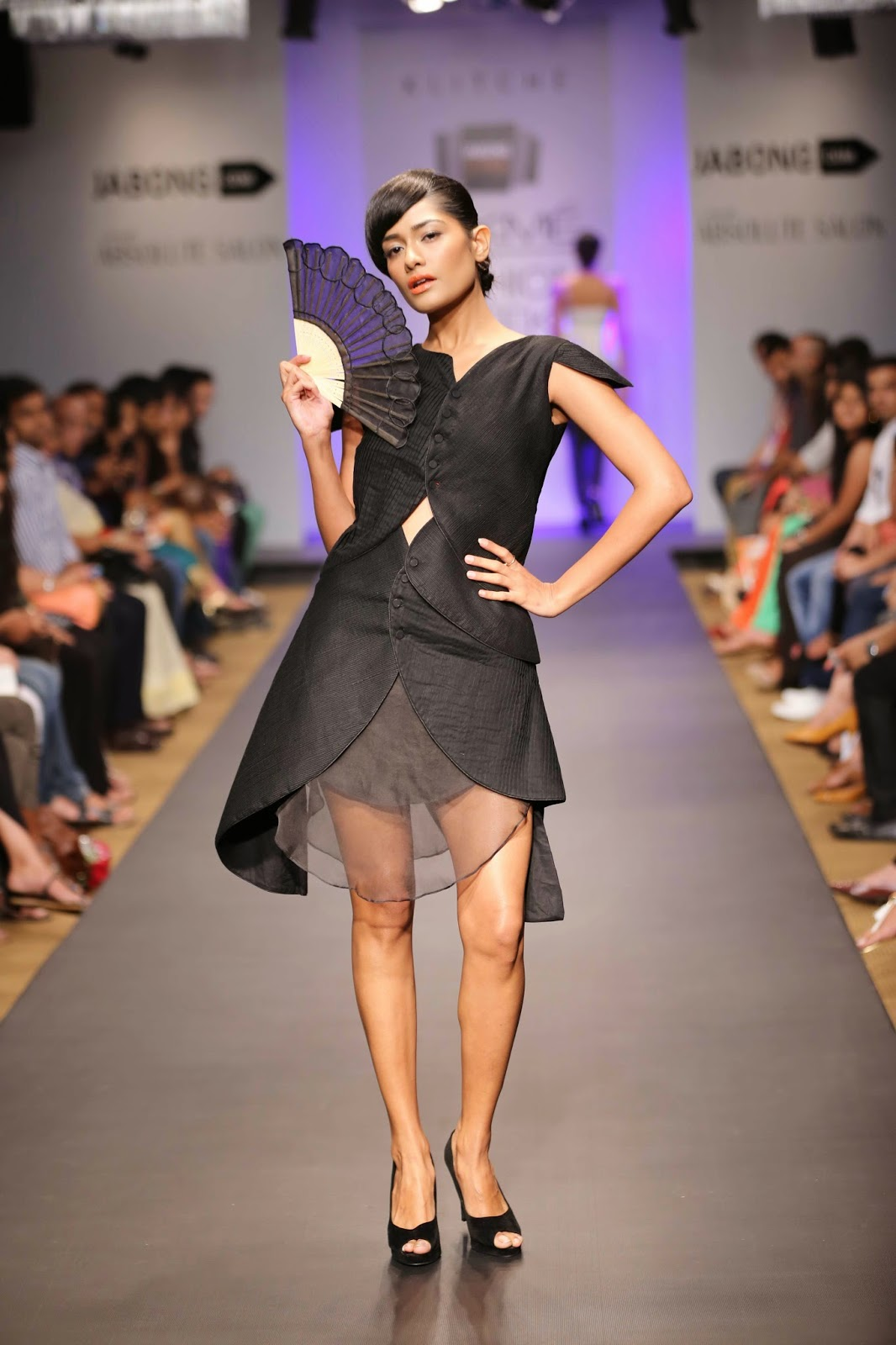 Isha Kedia under her label 'Klitché', showcased a trendy nature-meets-geometry inspired collection at Jabong Stage during Lakmé Fashion Week Summer/Resort 2014. The designer stuck to simple silhouettes like dresses, trousers, tunics, skirts and gowns crafted in light fabrics like chiffon and organza.