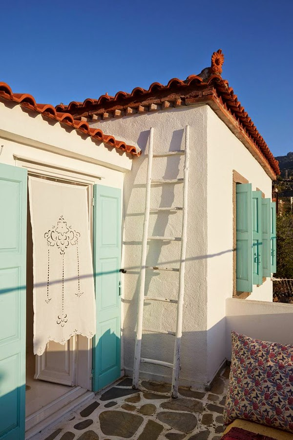 Greek house with baby blue shutters