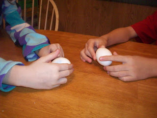 Spinning a raw and hard boiled egg .... which is which?