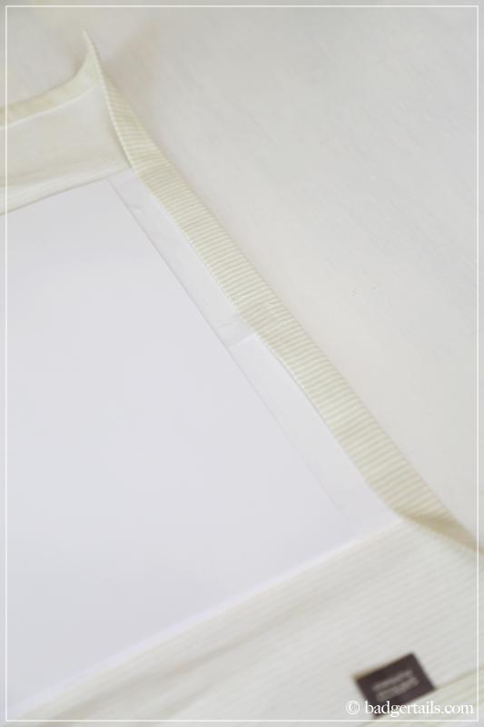 How to Frame a Tea Towel -  Tacking fabric onto the card
