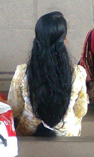 Malayalam girl in loose long hair style.