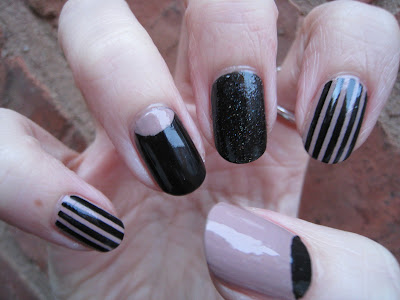 Half moon and stripes black and nude nail art