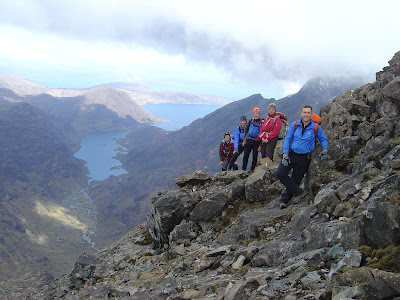 View of Loch Coruisk, Cuillin Ridge, Skye. Kendal Mountaineering Services group on the Cuillin Ridge.