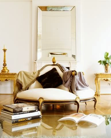 gilded gold circular settee in white foyer entry gold tables