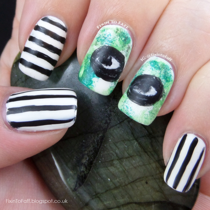 Nail art based on the movie Beetlejuice.