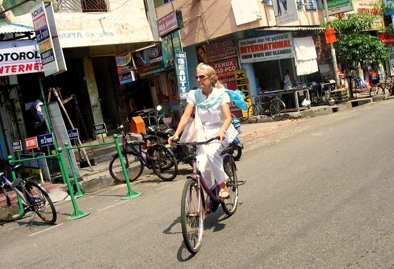 white woman on cycle in Puducherry