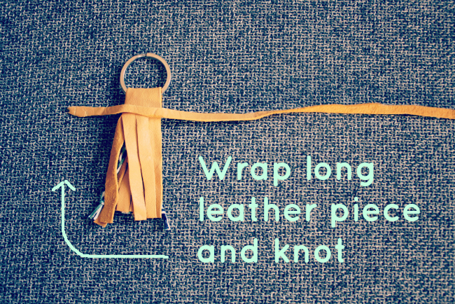 Wrap long leather piece around and knot
